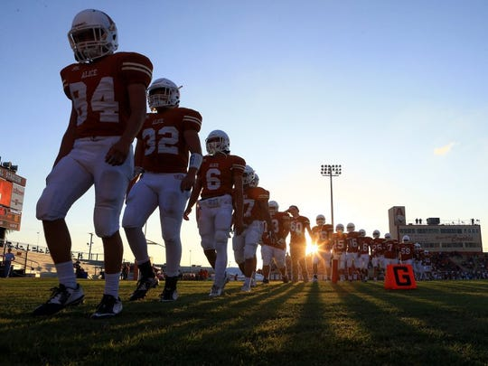 GABE HERNANDEZ/CALLER-TIMES Alice players walk back to the their locker room on Friday, Sept. 23, 2016, at Memorial Stadium in Alice.