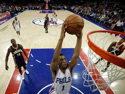 Philadelphia 76ers' Ish Smith (1) goes up for a dunk during the first half of an NBA basketball game against the Indiana Pacers, Saturday, April 2, 2016, in Philadelphia. (AP Photo/Matt Slocum)