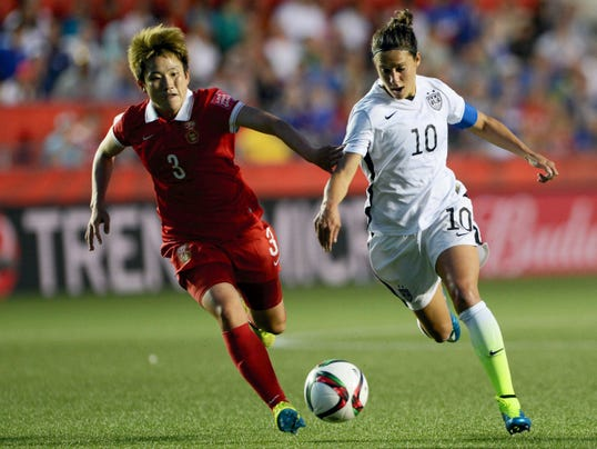 China's Pang Fengyue (3) chases United States' Carli Lloyd (10) during Friday's World Cup quarterfinal in Ottawa, Ontario.
