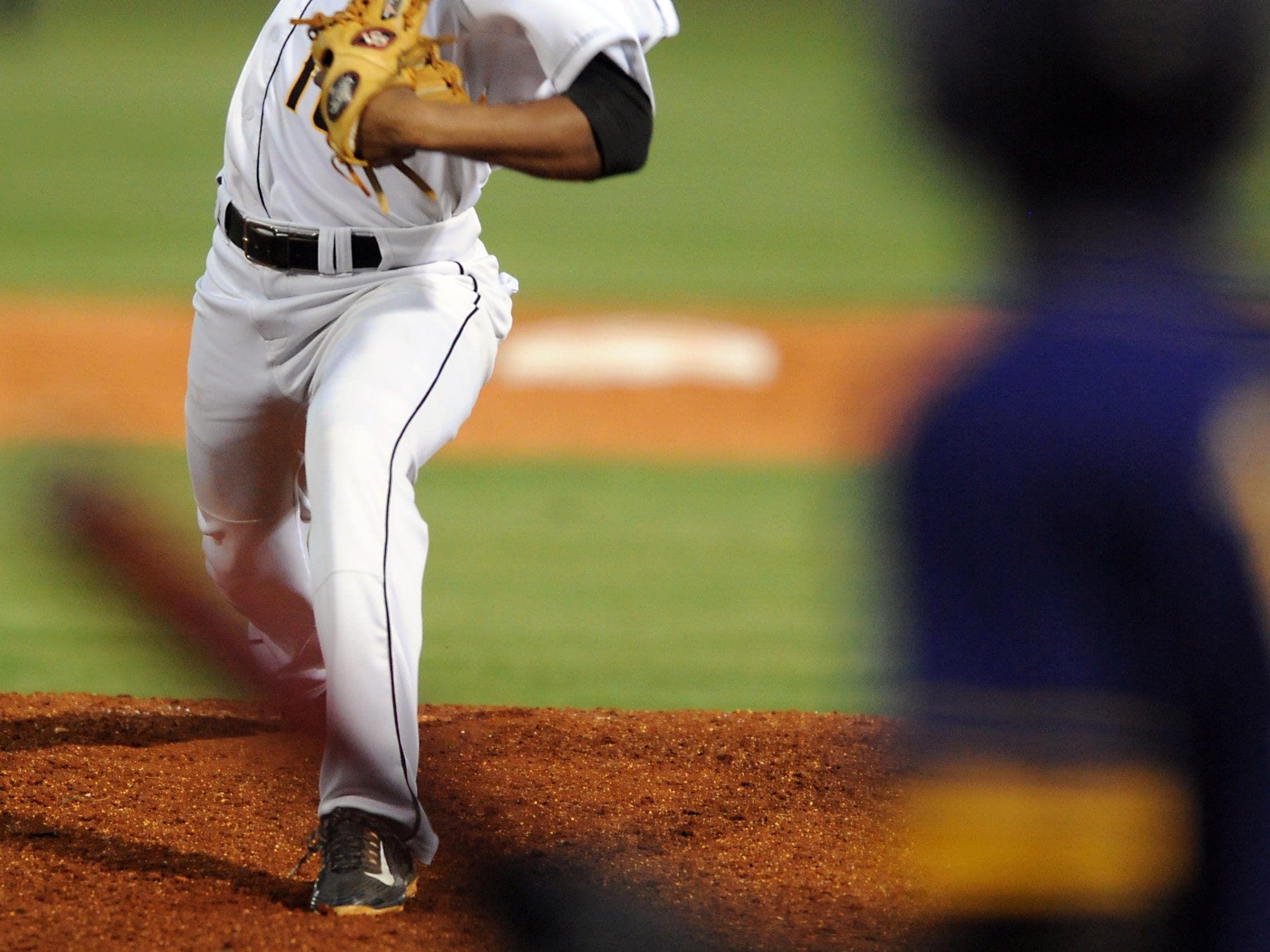 Oak Grove pitcher J.C. Keys delivers a pitch Tuesday during the Warriors' game against Hattiesburg at Oak Grove High School.
