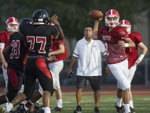 Brophy quarterback Chad McClanahan looks to pass during a scrimmage against Liberty.