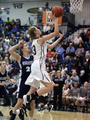 Rutgers Prep takes on Manasquan in the 2016 Girls Tournament of Champions basketball game at the Pine Belt Arena in Toms River on Friday March 18, 2016.Rutgers Prep's # 33 Madison Stanley gets past Manasquan's #  20 Nkki Stevens (left) for a 2nd half basket.