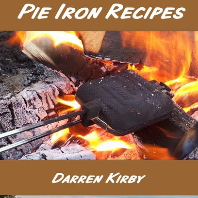 Turning and frequent peeks inside the pie iron are keys to turning out golden-brown pudgie pies.