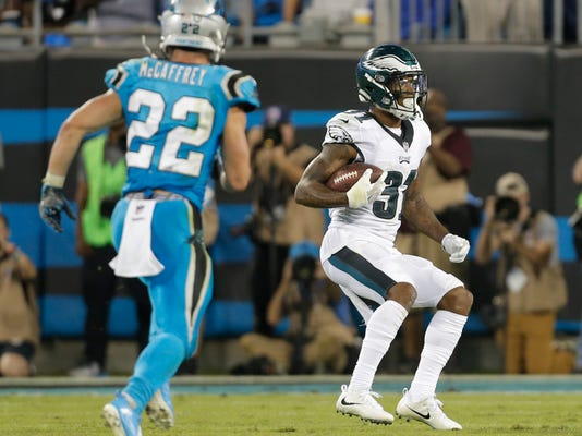 Carolina Panthers' Jairus Byrd (31) intercepts a Carolina Panthers pass as Carolina Panthers' Christian McCaffrey (22) watches in the second half of an NFL football game in Charlotte, N.C., Thursday, Oct. 12, 2017. (AP Photo/Bob Leverone)