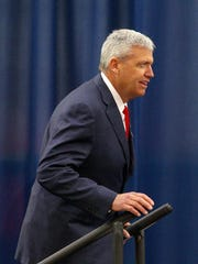 Rex Ryan walks to the stage during his introductory news conference in Orchard Park.