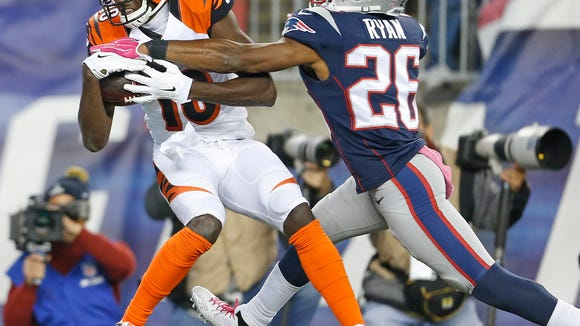 Cincinnati Bengals wide receiver A.J. Green (18) catches a touchdown pass in front of New England Patriots cornerback Logan Ryan (26) during the third quarter of their game played at Gillette Stadium in Foxborough, Massachusetts Sunday October 5, 2014. The Enquirer/Gary Landers