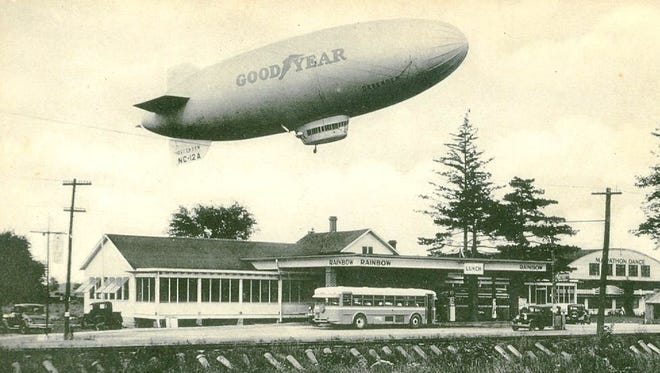 """Rainbow Garden, 1750 E. State Street, c. 1930s.   Even before the Goodyear Blimp circled football stadiums, one appears to hover here above the Rainbow Garden on E. State Street.  In its early heyday, the popular dance floor hosted such performers as Tommy and Jimmy Dorsey, Gene Krupa, Lawrence Welk, and """"Old Blue Eyes"""" himself.  Frank Sinatra sang there with Jo Stafford in the early 1940s.  Admission was 60 cents, and many local romances had there start around the fountain at the Rainbow Garden.  The rainbow shaped building at the right, which later became the home of Atlas Industries, still stands today."""