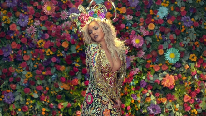 Beyonce, goddess of the flowers.