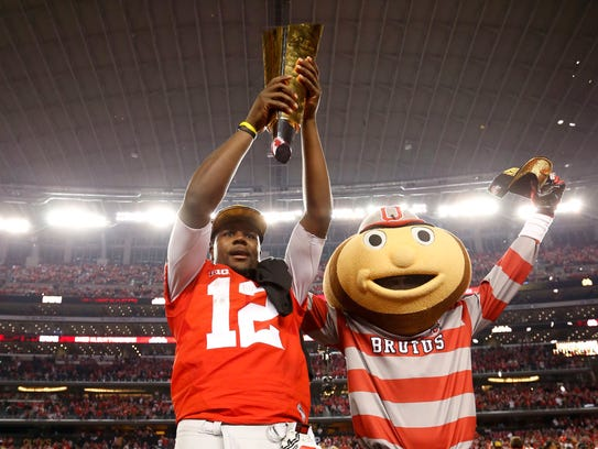 Ohio State quarterback Cardale Jones and Brutus after