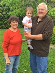 Pierce and his wife, Sandy, and great grandson Nash, in Lewisville.