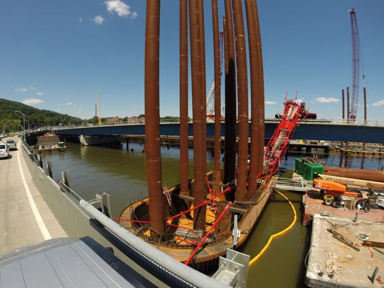Part of a collapsed crane remains on a pier between the piles it had been working on driving in during construction of the new Tappan Zee Bridge July 20, 2016.