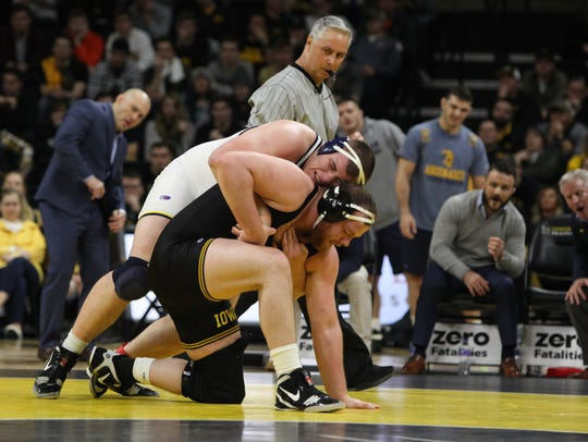 Iowa's Sam Stoll wrestles Michigan's Adam Coon at 285