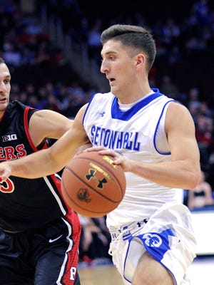 Seton Hall guard Jaren Sina, right, drives to the basket as he is guarded by Rutgers guard Kerwin Dadika during the second half of an NCAA college basketball game Saturday, Dec. 6, 2014, in Newark, N.J.