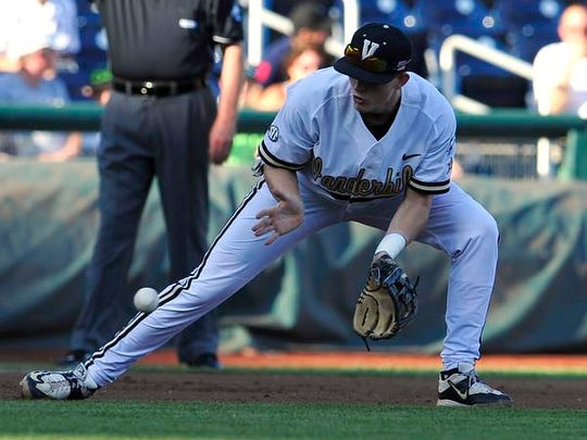 Vanderbilt's Will Toffey fields a ground ball against TCU during the first inning in the College World Series on June 19, 2015.