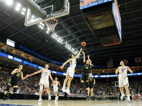 Oregon Ducks guard Sabrina Ionescu (20) shoots the ball over Connecticut Huskies guard Gabby Williams (15) during the second half in the finals of the Bridgeport Regional of the women's 2017 NCAA Tournament at Webster Bank Arena. The Huskies won 90-52.