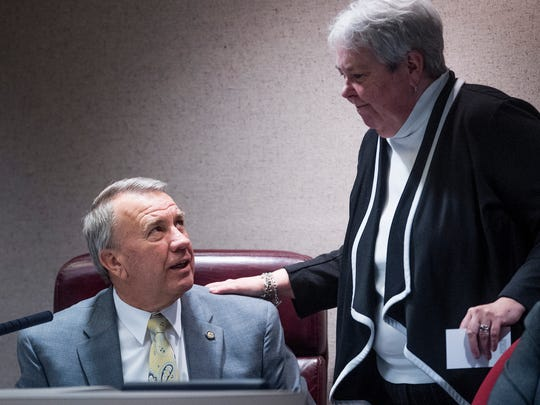 Speaker of the House Mac McCutcheon, left, talks with Rep. Patricia Todd on the house floor at the Alabama Statehouse in Montgomery, Ala. on Tuesday March 27, 2018.