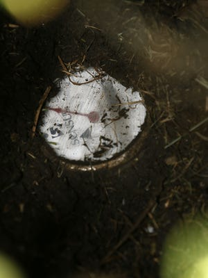 A water meter was buried in dirt, part of an aging drinking water infrastructure in New Orleans. Water rates have been shooting up nationwide. Experts say the trend is sure to accelerate as the cost of water, treatment and delivery comes into line with how essential it is to our daily lives.
