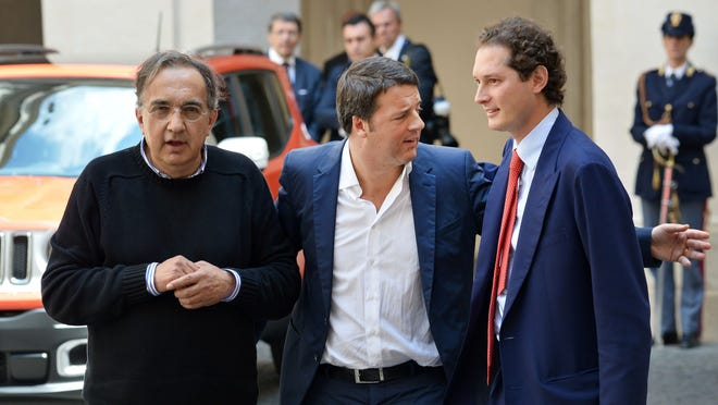 Italy's Prime Minister Matteo Renzi, right, speaks with Italian automaker Fiat's chairman John Elkann as Fiat Chrysler Automobiles Group Chief Executive Officer Sergio Marchionne, left, looks on July 25, 2014 at the Palazzo Chigi in Rome.