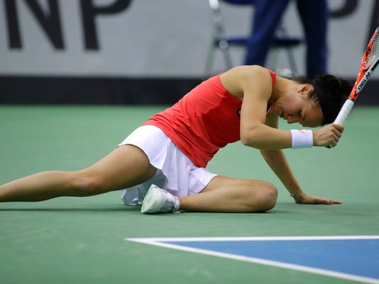 Viktorija Golubic, of Switzerland, reacts after missing a point against Aryna Sabalenka, of Belarus, during the Fed Cup World Group semi final tennis match between Belarus and Switzerland, in Minsk, Belarus, Sunday, April 23, 2017. (AP Photo/Sergei Grits)