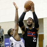 Los Angeles Clippers' Branden Dawson goes up for a shot over Orlando Magic White's Aaron Bowen during the first half of an NBA summer league game, Thursday, July 7, 2016, in Orlando, Fla.