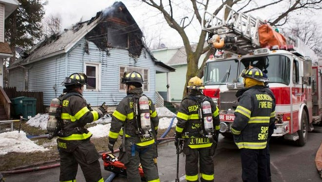 Firefighters at the scene at 50 Van Stallen St. The two-alarm fire heavily damaged the home.