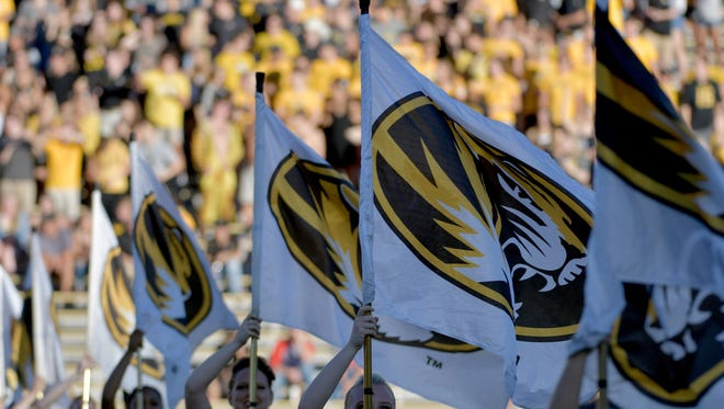 The Missouri Tigers flag corps entertain the fans.