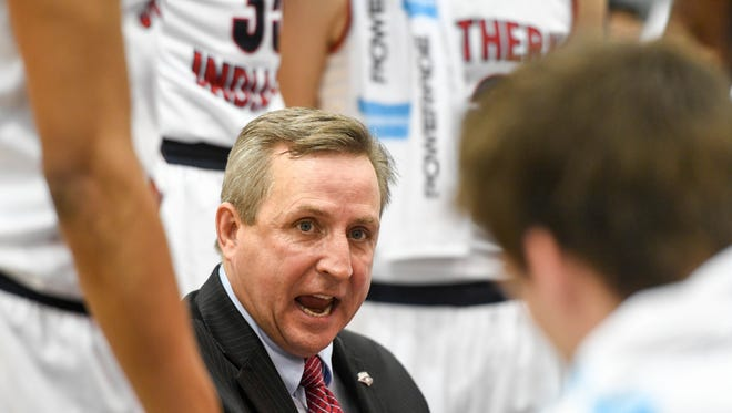 USI head coach Rodney Watson talks to his team during a second period time out as the University of Southern Indiana plays Bellarmine University at the PAC Arena Monday, January 16, 2016.