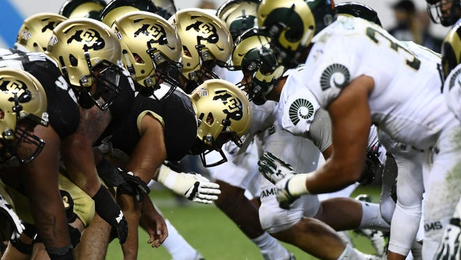 CSU football players go head-to-head with CU players during the second half of last year's Rocky Mountain Showdown in Denver. The schools only have three more games against each other scheduled in Denver, including this year's matchup on Friday night.