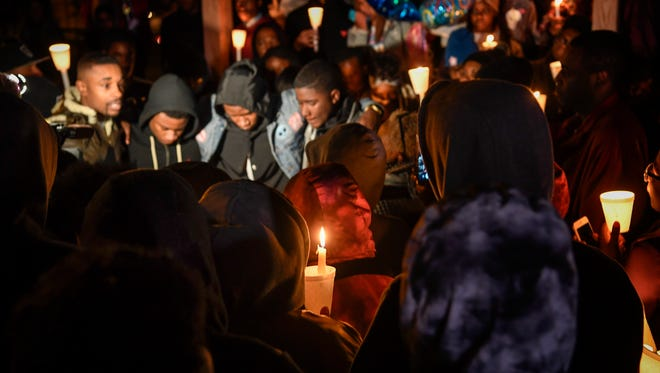 Hundreds gather to pay respects to 17-years-old Ja'Donte Thompson at Watkins Park bring awareness of the killing in Nashville, Tenn., Thursday, Dec. 7, 2017.