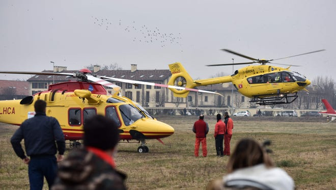 Rescue helicopters evacuate victims on the site of a train derailment, on January 25, 2018 near Milan.