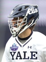 Ben Reeves of the Yale Bulldogs looks on during the