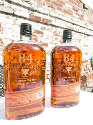 Customized bottles of Bulleit Bourbon served as trophies for individual events at the B4 Derby Olympics on Tuesday afternoon. 4/21/15