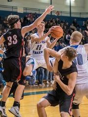 Harper Creek's Jeremiah Davis (11) goes for the hoop