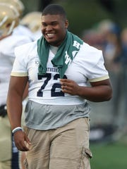 Indianapolis Cathedral's Emil Ekiyor on the sidelines during the first half of King's win over Indianapolis Cathedral, 38-35, on Saturday, Aug. 26, 2017, at Wayne State.