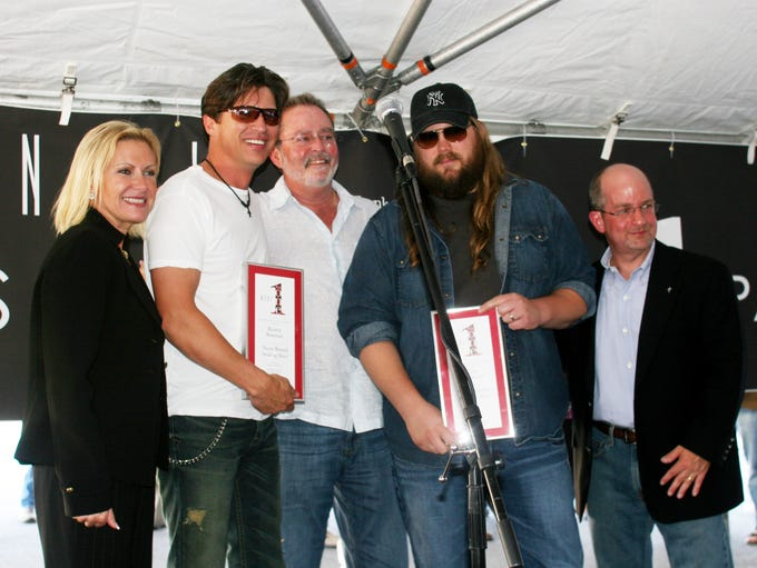 CMA CEO Tammy Genovese, left, songwriter Ronnie Bowman,