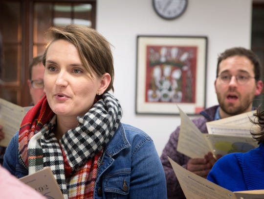 Katelyn Hobin and her husband Grant sing during choir practice at Westminster Presbyterian Church in Beaverdale Thursday, Nov. 16, 2017. They both work part-time jobs in the choir and told the Register they struggled to afford their middle-class lifestyles.