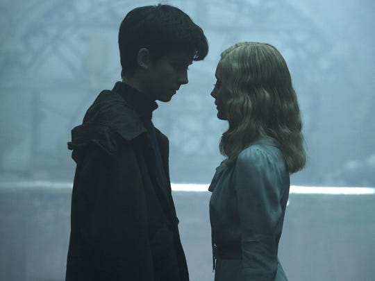 "Asa Butterfield, left, and Ella Purnell appear in a scene from ""Miss Peregrine's Home for Peculiar Children."""