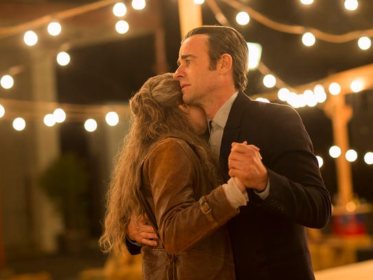 Kevin (right, Justin Theroux) shares a dance with Nora