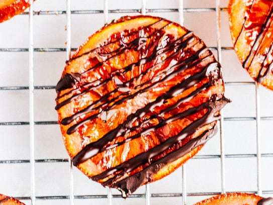 Candied Blood Orange Slices are drizzled with chocolate.