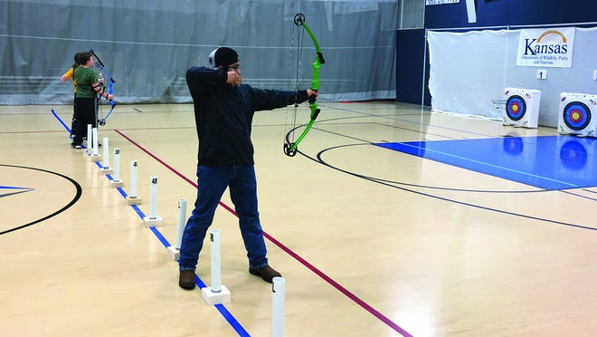 Pratt High School Student Angel Hernandez takes aim (above) during the Pratt Archery Tournament at Blythe Family Fitness last Saturday.