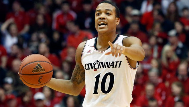 Bearcats guard Troy Caupain controls the ball during the first half against Temple on Jan. 17.