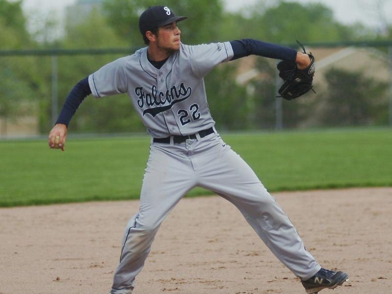 Senior third baseman Ravi Mahanti makes the throw to first base after fielding a ground ball.