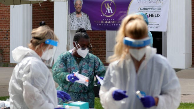 Volunteers test during the Greater Mitchell Temple Church of God in Christ community service day that offered free COVID-19 testing in honor of church mother Willie Mae Sheard who passed from complications of the coronavirus April 19. Locals were tested free of charge June 3, 2020 in Detroit.