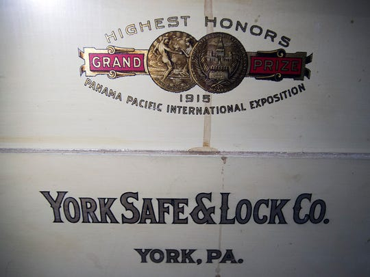 A York Safe & Lock Co logo on a safe in the basement, touts winning honors in an 1915 international exposition.  Paul Kuehnel - York Daily Record/ Sunday News