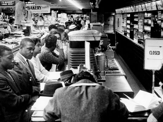 The ?closed? sign goes up as soon as black college students sit at the counter of the downtown Nashville Woolworth?s on Feb. 27, 1960. Later at the store, a group of white boys attacked two black demonstrators after receiving no response from comments such as ?Go home, (N-word)? and ?What?s the matter, you chicken?? File / The Tennessean