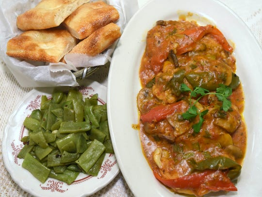 Chicken breast cacciatore with Italian beans and homemade pizza bread served at Vince's Italian Restaurant on Springwells at Homer in Southwest Detroit. (Todd McInturf, The Detroit News)