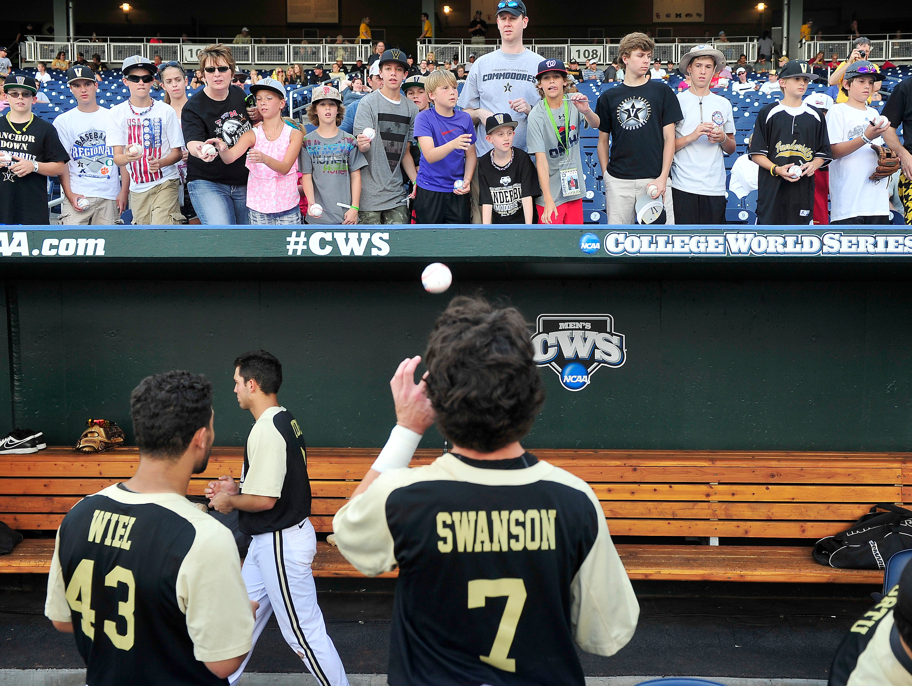 Vanderbilt fans try to get autographs from players prior to the game 3 against Virginia at the College World Series at TD Ameritrade Park in Omaha, Neb., Wednesday, June 25, 2014.