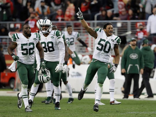 New York Jets outside linebacker Darron Lee (50) and teammates celebrate after overtime of an NFL football game against the San Francisco 49ers in Santa Clara, Calif., Sunday, Dec. 11, 2016. The Jets won 23-17. (AP Photo/Marcio Jose Sanchez)