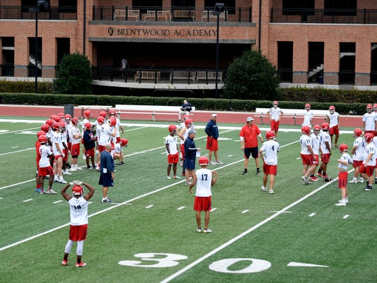 Brentwood Academy football team practices during an