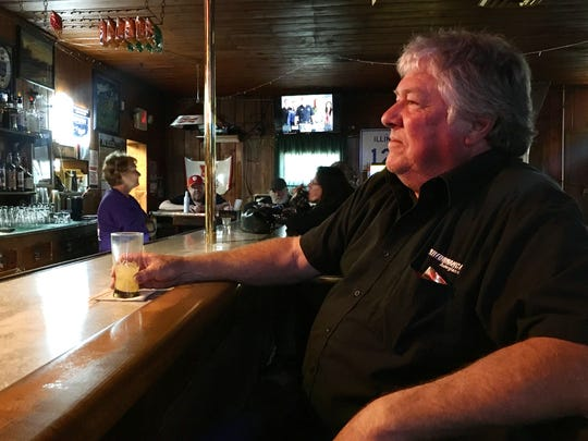 Bob Smith, owner of a glass repair business in Tazewell County, Ill., has a drink in WayneÕs 121 Club, just down the road from the crane business, owned by the family of Antioch Waffle House shooting suspect Travis Reinking.  Smith says he knows ReinkingÕs father as a respected businessman in the community.